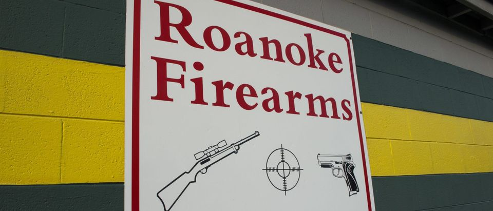 """A sign on the outside wall of Roanoke Firearms is seen on August 28, 2015, in Roanoke, Virginia. With mass shootings seemingly on a daily basis, it appears no place in the United States is safe from carnage: not churches, not schools, not even the morning newscast.The shocking on-air murder of a young reporter and a cameraman by a disgruntled former colleague August 26, 2015 has once again renewed calls for stricter gun controls.That is simply not going to happen, experts said, and the trend in recent years has actually gone in the opposite direction.""""You can't get rid of them,"""" Harry Wilson, a professor at Roanoke College in Virginia -- near the scene of the latest shooting -- (PAUL J. RICHARDS/AFP via Getty Images)"""