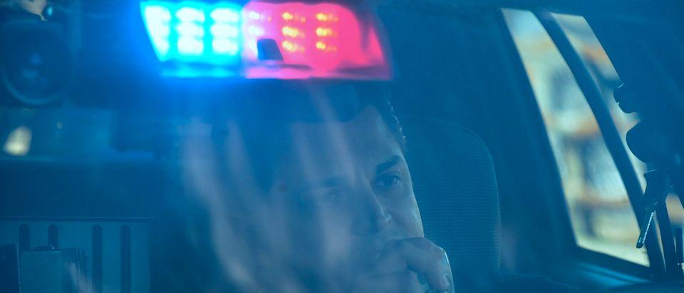 A Policeman Inside A Car