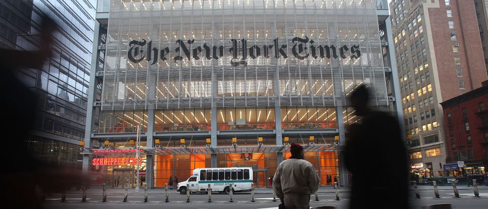 The New York Times' masthead is displayed in front of the midtown headquarters on December 7, 2009 in New York City. Mario Tama/Getty Images)