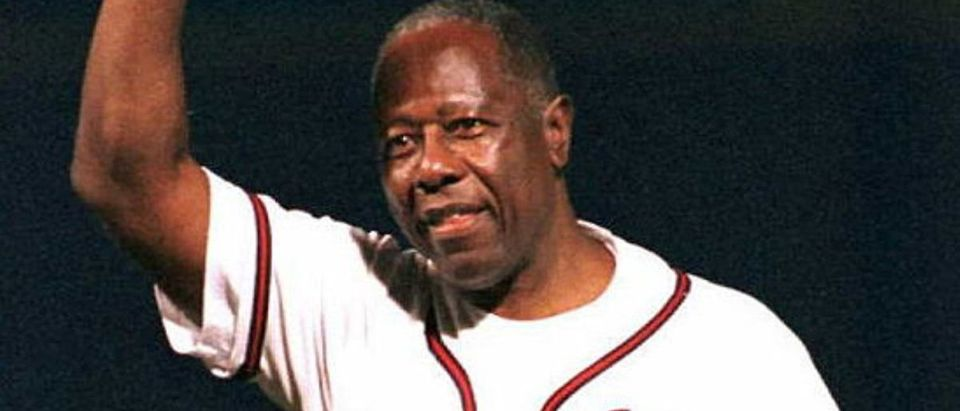 Hank Aaron waves to fans before making some brief