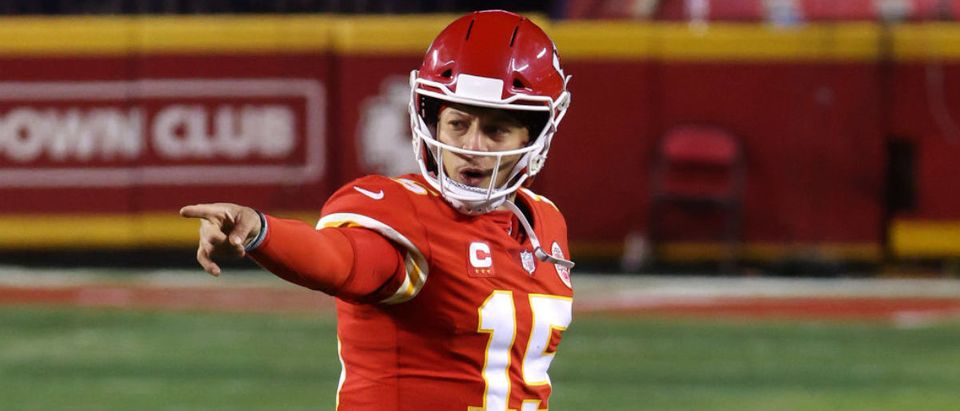 KANSAS CITY, MISSOURI - JANUARY 24: Patrick Mahomes #15 of the Kansas City Chiefs celebrates in the fourth quarter against the Buffalo Bills during the AFC Championship game at Arrowhead Stadium on January 24, 2021 in Kansas City, Missouri. (Photo by Jamie Squire/Getty Images)