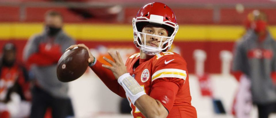 KANSAS CITY, MISSOURI - JANUARY 24: Patrick Mahomes #15 of the Kansas City Chiefs throws a pass in the first half against the Buffalo Bills during the AFC Championship game at Arrowhead Stadium on January 24, 2021 in Kansas City, Missouri. (Photo by Jamie Squire/Getty Images)