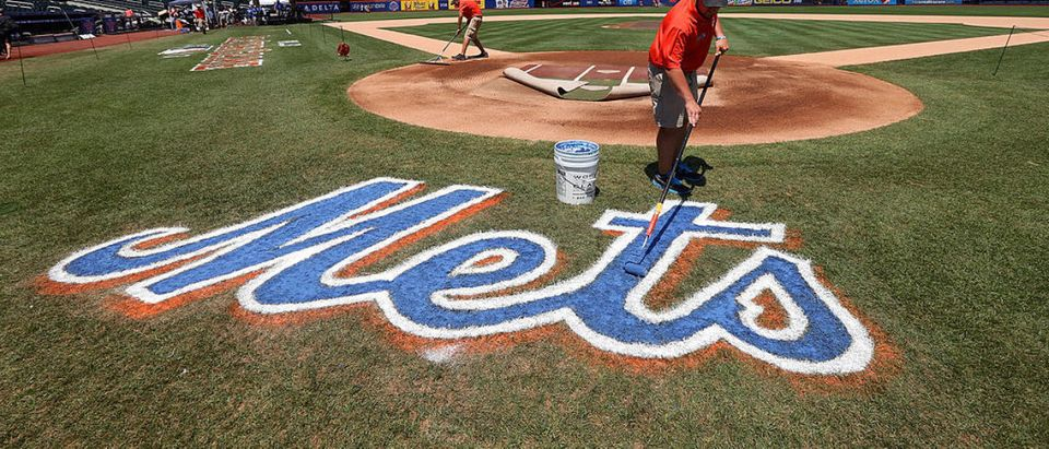 NEW YORK, NY - JULY 16: A grounds crew member paints the Mets logo on the field during the 84th MLB All-Star Game on July 16, 2013 at Citi Field in the Flushing neighborhood of the Queens borough of New York City. (Photo by Bruce Bennett/Getty Images)