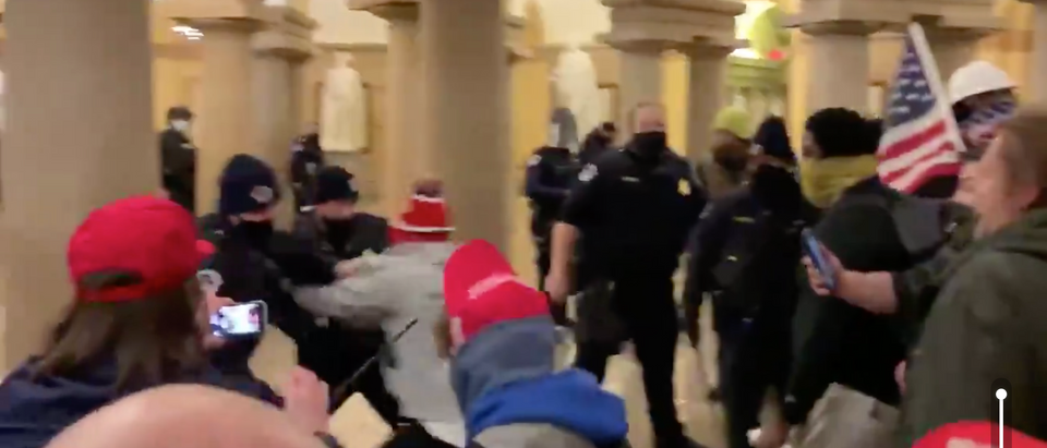 Rioters brawl with police officers after storming the Capitol Building (Screenshot/Twitter Elijah Schaffer)