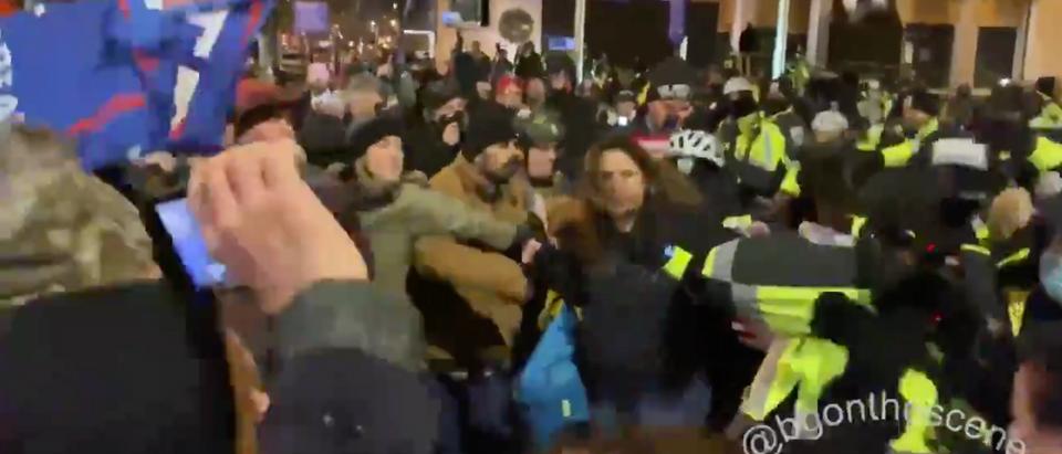 Trump supporters clash with Washington D.C. Police near Black Lives Matter Plaza Tuesday Night (Screenshot/Twitter Brendan Gutenschwager)