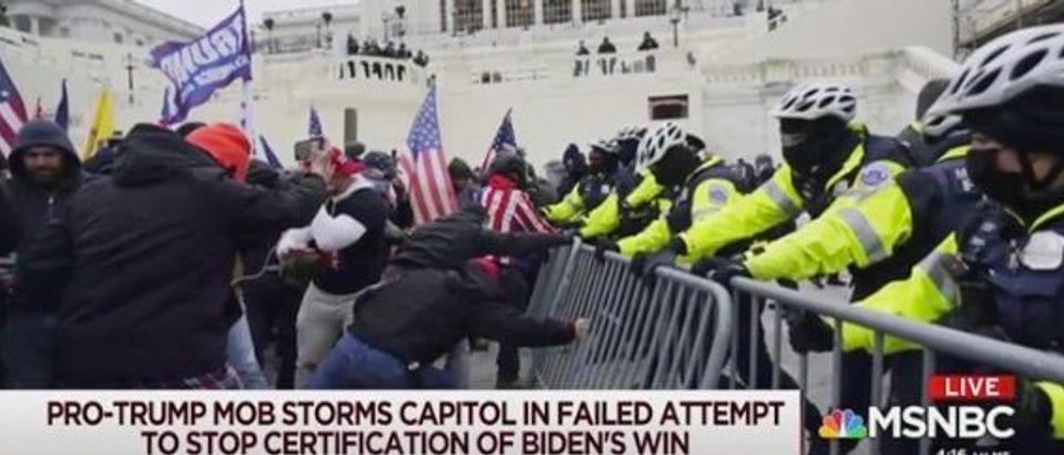 Mob attempts to break through police line (Screenshot/MSNBC)