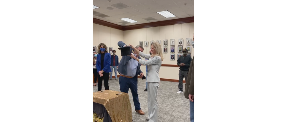 Dickinson Mayoral Candidates have a tie-breaking ceremony to decide the mayor [Facebook/Screenshot/City of Dickinson, Texas]