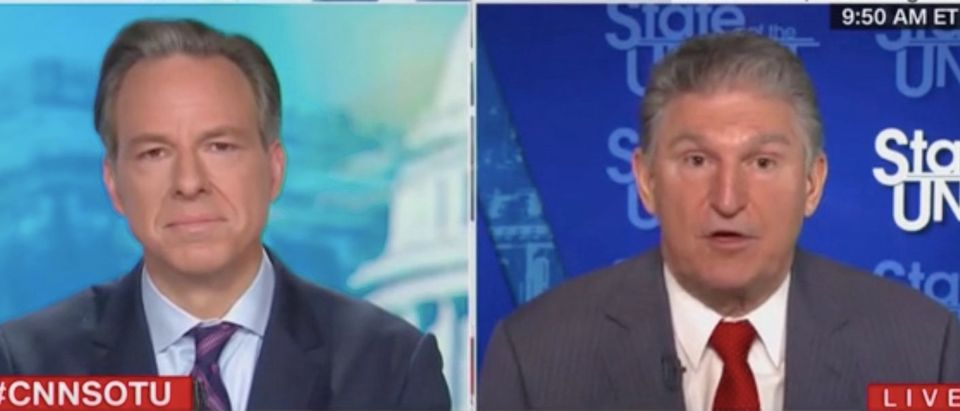 "Jake Tapper speaks with Sen. Joe Manchin on ""State of the Union."" Screenshot/CNN"