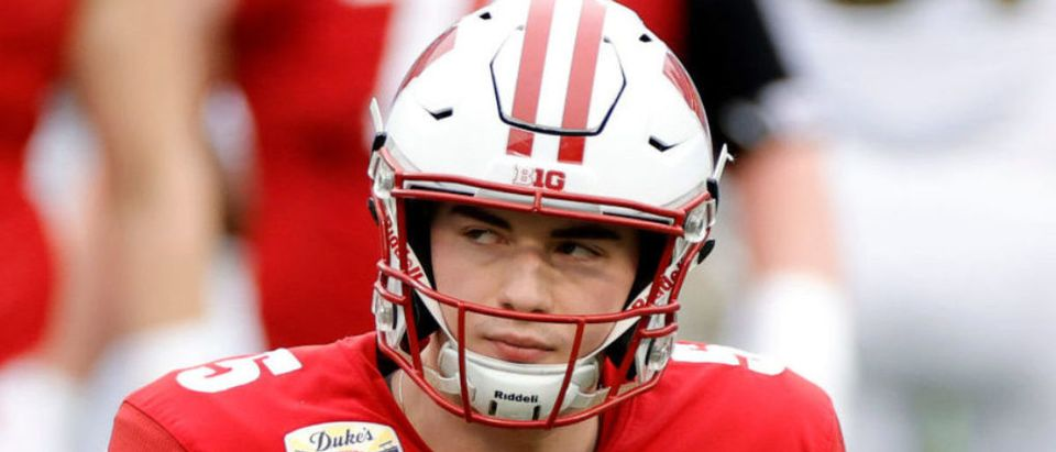 CHARLOTTE, NORTH CAROLINA - DECEMBER 30: Quarterback Graham Mertz #5 of the Wisconsin Badgers looks on against the Wake Forest Demon Deacons during the first half of the Duke's Mayo Bowl at Bank of America Stadium on December 30, 2020 in Charlotte, North Carolina. (Photo by Jared C. Tilton/Getty Images)