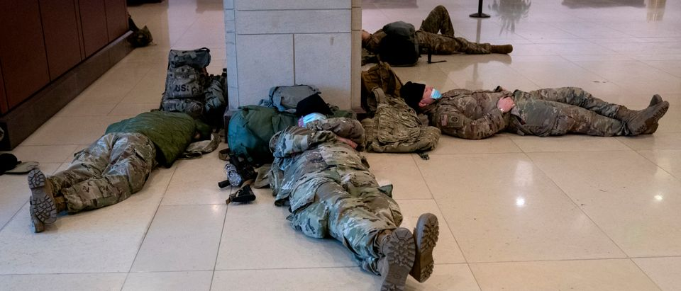 WASHINGTON, DC - JANUARY 14: Members of the National Guard sleep in the Visitor Center of the U.S. Capitol on January 14, 2021 in Washington, DC. Security has been increased throughout Washington following the breach of the U.S. Capitol last Wednesday, and leading up to the Presidential Inauguration. (Photo by Stefani Reynolds/Getty Images)