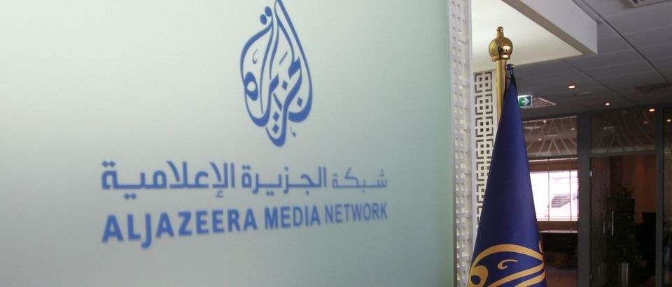 The Al Jazeera Media Network logo is seen inside its headquarters in Doha, Qatar June 8, 2017. (REUTERS/Naseem Zeitoon)