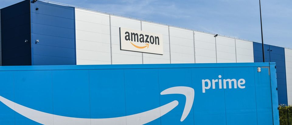 An Amazon delivery lorry is parked outside the Amazon logistics centre in Lauwin-Planque, northern France, on April 16, 2020. - Amazon France said on April 16, 2020, it did not know when it would reopen its distribution centres, shuttered after a court ordered it to limit deliveries to essential goods pending a review of anti-coronavirus safety measures for its staff. (Photo by Denis Charlet/AFP via Getty Images)