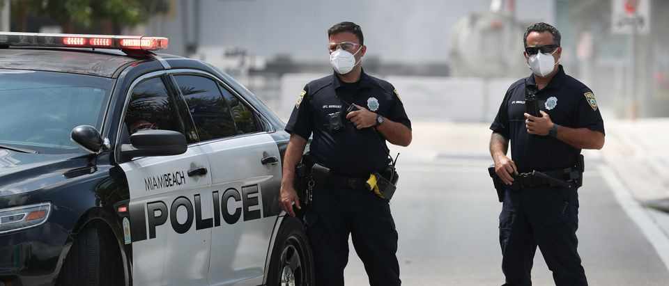 Miami Beach police officers wear protective masks