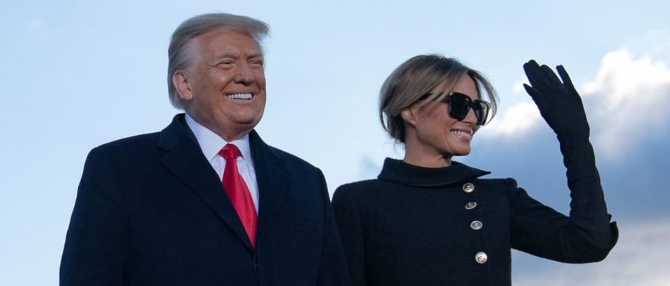 Outgoing US President Donald Trump and First Lady Melania Trump address guests at Joint Base Andrews in Maryland on January 20, 2021. - President Trump and the First Lady travel to their Mar-a-Lago golf club residence in Palm Beach, Florida, and will not attend the inauguration for President-elect Joe Biden. (Photo by ALEX EDELMAN/AFP via Getty Images)