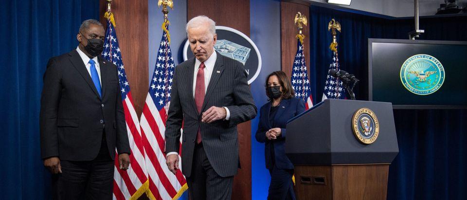 US President Joe Biden leaves after speaking alongside US Vice President Kamala Harris (R) and US Secretary of Defense Lloyd Austin (L) during a visit to the Pentagon in Washington, DC, February 10, 2021. (Photo by Saul Loeb/AFP via Getty Images)