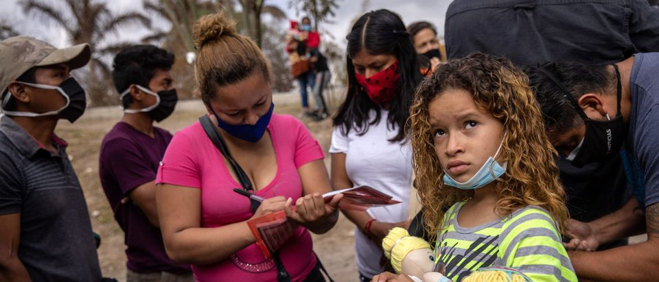 """Asylum Seekers Cross Into U.S. In Reversal Of Trump's """"Remain In Mexico"""" Policy"""