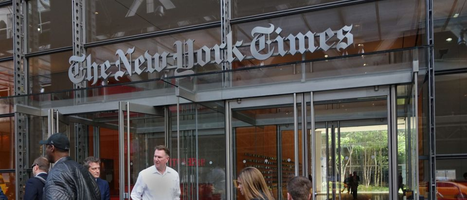 People walk past the west entrance of the New York Times building at 620 Eighth Ave. April 28, 2016 in New York. (DON EMMERT/AFP via Getty Images)