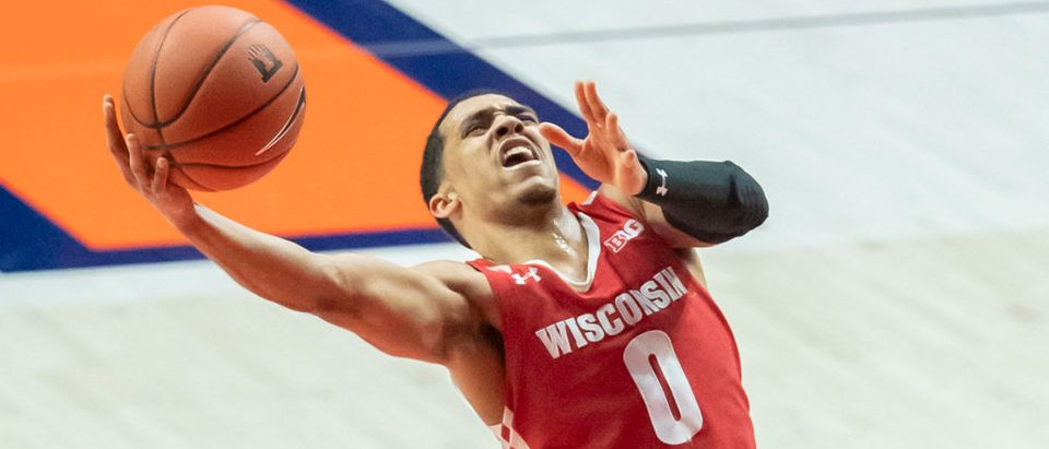 Feb 6, 2021; Champaign, Illinois, USA; Wisconsin Badgers guard D'Mitrik Trice (0) goes up for a layup during the second half against the Illinois Fighting Illini at State Farm Center. Mandatory Credit: Patrick Gorski-USA TODAY Sports via Reuters
