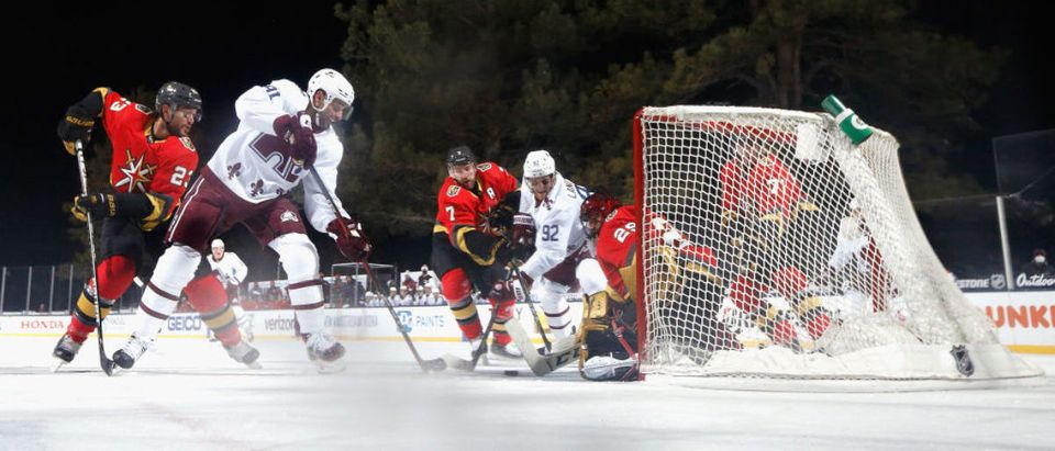STATELINE, NEVADA - FEBRUARY 20: Pierre-Edouard Bellemare #41 and Gabriel Landeskog #92 of the Colorado Avalanche are stopped by Marc-Andre Fleury #29 of the Vegas Golden Knights during the second period during the NHL Outdoors at Lake Tahoe at the Edgewood Tahoe Resort on February 20, 2021 in Stateline, Nevada. (Photo by Christian Petersen/Getty Images)
