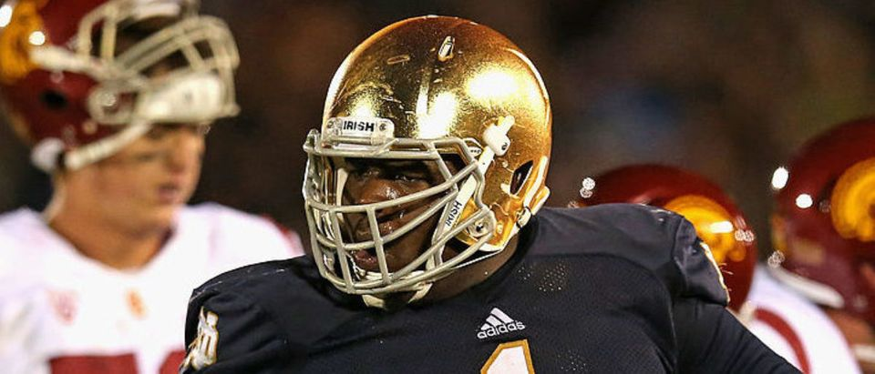 SOUTH BEND, IN - OCTOBER 19: Louis Nix III #1 of the Notre Dame Fighting Irish celebrates near the end of the game against the University of Southern California Trojans at Notre Dame Stadium on October 19, 2013 in South Bend, Indiana. Notre Dame defeated USC 14-10. (Photo by Jonathan Daniel/Getty Images)