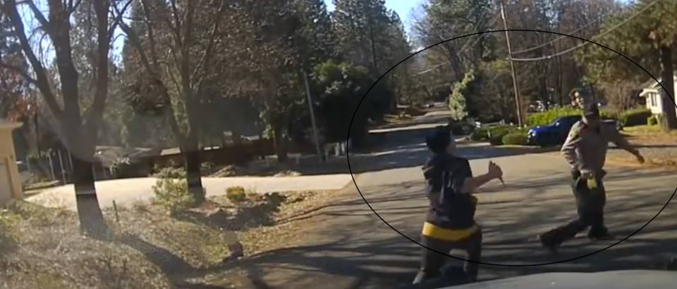 Ariella Crawford can be seen chasing a Nevada County Sheriff with a knife from newly released dash-cam footage [Youtube/Screenshot/Nevada County Sheriff's Office]