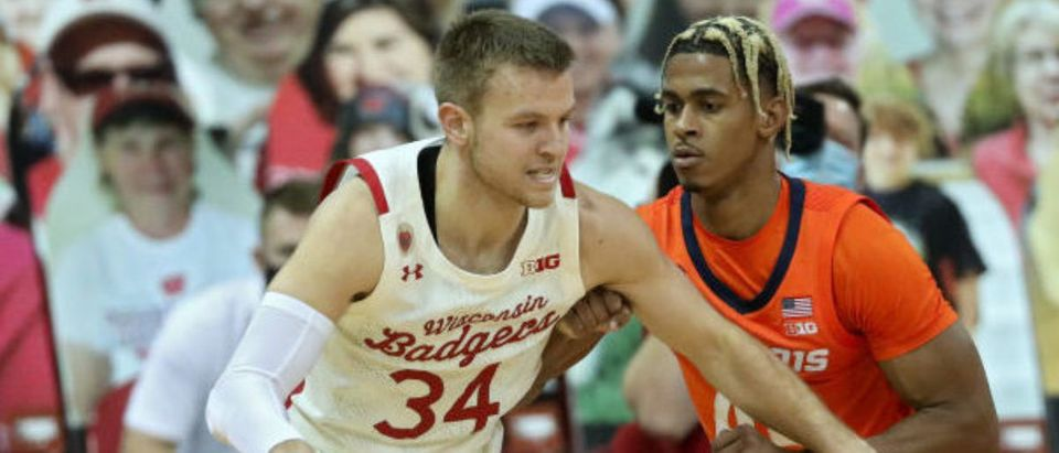 MADISON, WISCONSIN - FEBRUARY 27: Brad Davison #34 of the Wisconsin Badgers dribbles the ball while being guarded by Adam Miller #44 of the Illinois Fighting Illini in the first half at the Kohl Center on February 27, 2021 in Madison, Wisconsin. (Photo by Dylan Buell/Getty Images)