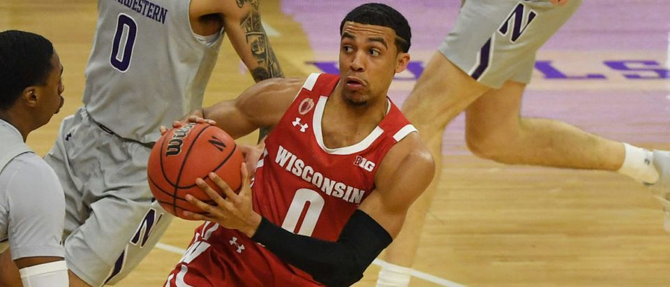 Feb 21, 2021; Evanston, Illinois, USA; Wisconsin Badgers guard D'Mitrik Trice (0) looks to pass the basketball in the first half against the Northwestern Wildcats at Welsh-Ryan Arena. Mandatory Credit: Quinn Harris-USA TODAY Sports via Reuters