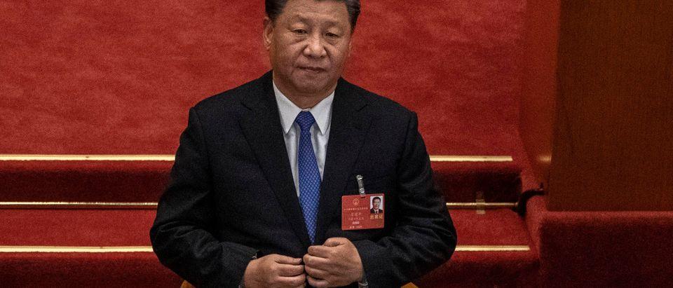 Xi Jinping Joe Biden CCP Getty Uighurs Hong Kong