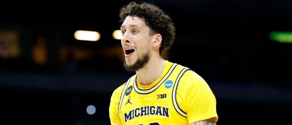 INDIANAPOLIS, INDIANA - MARCH 22: Brandon Johns Jr. #23 of the Michigan Wolverines reacts after a foul call against the LSU Tigers in the second round game of the 2021 NCAA Men's Basketball Tournament at Lucas Oil Stadium on March 22, 2021 in Indianapolis, Indiana. (Photo by Tim Nwachukwu/Getty Images)