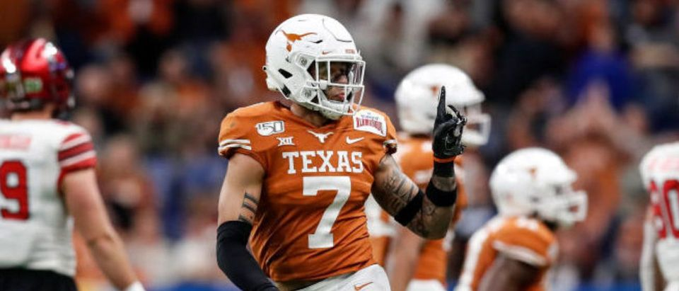 SAN ANTONIO, TX - DECEMBER 31: Caden Sterns #7 of the Texas Longhorns reacts after a stop in the third quarter against the Utah Utes during the Valero Alamo Bowl at the Alamodome on December 31, 2019 in San Antonio, Texas. (Photo by Tim Warner/Getty Images)