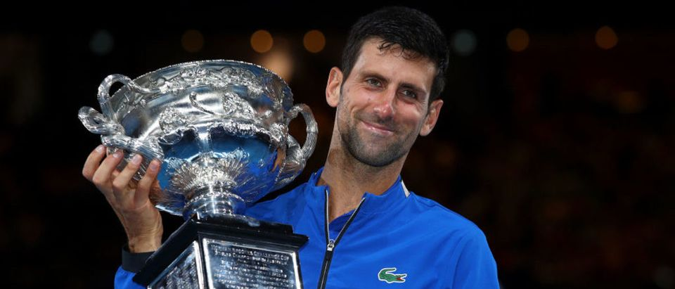 MELBOURNE, AUSTRALIA - JANUARY 27: Novak Djokovic of Serbia poses with the Norman Brookes Challenge Cup following victory in his Men's Singles Final match against Rafael Nadal of Spain during day 14 of the 2019 Australian Open at Melbourne Park on January 27, 2019 in Melbourne, Australia. (Photo by Julian Finney/Getty Images)