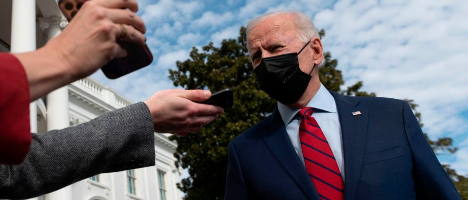 US President Joe Biden speaks to reporters as he departs for Wilmington, Delaware, from the South Lawn of the White House in Washington, DC, on February 27, 2021. (Photo by ANDREW CABALLERO-REYNOLDS/AFP via Getty Images)