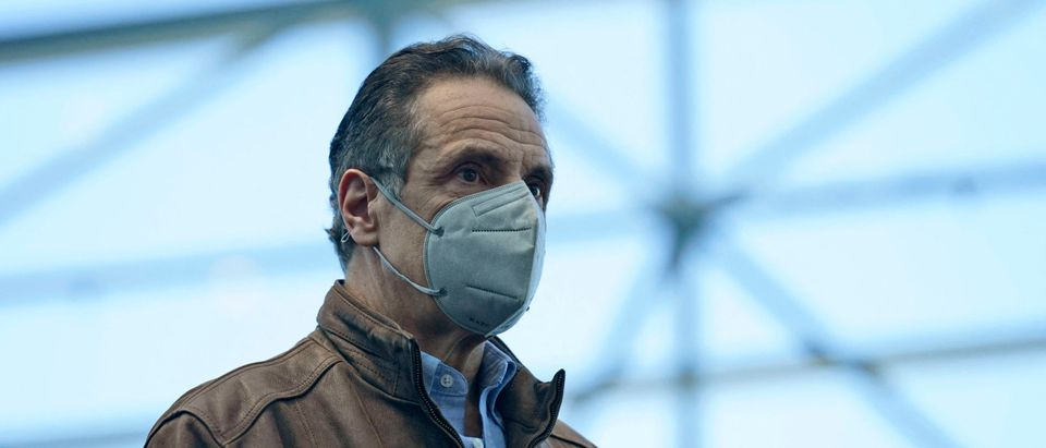 New York Governor Andrew Cuomo listens to speakers at a vaccination site on March 8, 2021, in New York. (Photo by Seth Wenig/POOL/AFP via Getty Images)