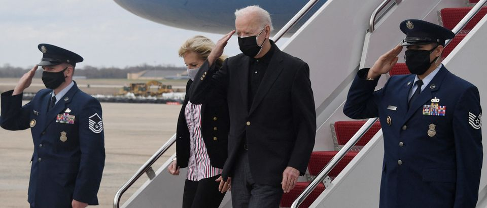 US President Joe Biden and First Lady Jill Biden (L) disembarks Air Force One after spending the weekend in Wilmington, at Joint Base Andrews in Maryland, near Washington, on March 28, 2021. (Photo by OLIVIER DOULIERY/AFP via Getty Images)