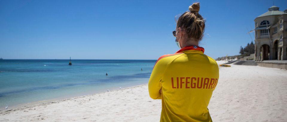 Lifeguard Looking At The Beach