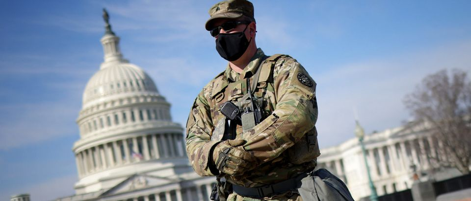 National Guard trooper standing in front of Capitol