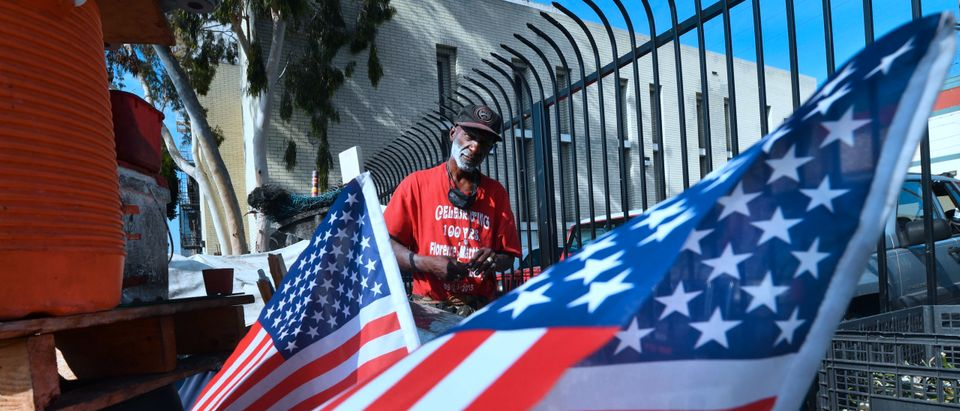 Flags are hoisted at the street corner encampment of homeless veteran Kendrick Bailey on November 10, 2017 in Los Angeles, California, one of the nation's largest homeless populations which saw a 57 percent increase in the number of homeless vets living on Los Angeles streets from last year. Bailey, who says he served in Vietnam, said he has been living on the streets since at least as long as Obama became president. Veterans Day, an official United States public holiday, is observed annually on November 11th. (Photo by Frederic J. Brown/AFP via Getty Images)