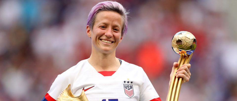 Megan Rapinoe of the USA poses for a photograph with the Golden Boot award and the Golden Ball award following the 2019 FIFA Women's World Cup France Final match between The United States of America and The Netherlands at Stade de Lyon on July 07, 2019 in Lyon, France. (Photo by Richard Heathcote/Getty Images)