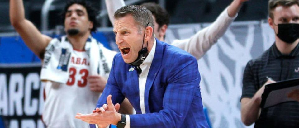 INDIANAPOLIS, INDIANA - MARCH 22: Head coach Nate Oats of the Alabama Crimson Tide reacts in the first half against the Maryland Terrapins in the second round game of the 2021 NCAA Men's Basketball Tournament at Bankers Life Fieldhouse on March 22, 2021 in Indianapolis, Indiana. (Photo by Sarah Stier/Getty Images)