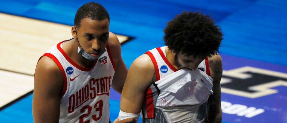 Mar 19, 2021; West Lafayette, Indiana, USA; Ohio State Buckeyes forward Zed Key (23) and guard Duane Washington Jr. (4) react as they leave the court after overtime loss to the Oral Roberts Golden Eagles in the first round of the 2021 NCAA Tournament at Mackey Arena. Mandatory Credit: Joshua Bickel-USA TODAY Sports via Reuters