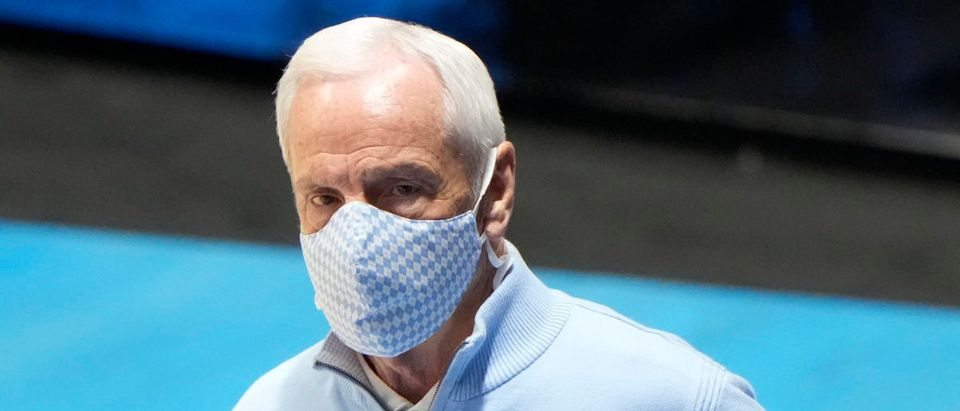Mar 19, 2021; West Lafayette, Indiana, USA; North Carolina Tar Heels head coach Roy Williams reacts during the first half against the Wisconsin Badgers in the first round of the 2021 NCAA Tournament at Mackey Arena. Mandatory Credit: Mike Dinovo-USA TODAY Sports via Reuters