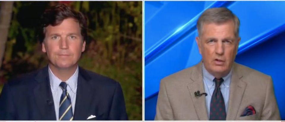 "Tucker Carlson speaks with Brit Hume on ""Tucker Carlson Tonight."" Screenshot/Fox News"