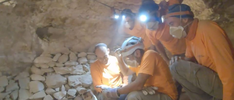 Archaeologists At The Caves