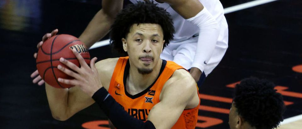 KANSAS CITY, MISSOURI - MARCH 11: Cade Cunningham #2 of the Oklahoma State Cowboys grabs a rebound during the quarterfinal game of the Big 12 basketball tournament against the West Virginia Mountaineers at the T-Mobile Center on March 11, 2021 in Kansas City, Missouri. (Photo by Jamie Squire/Getty Images)