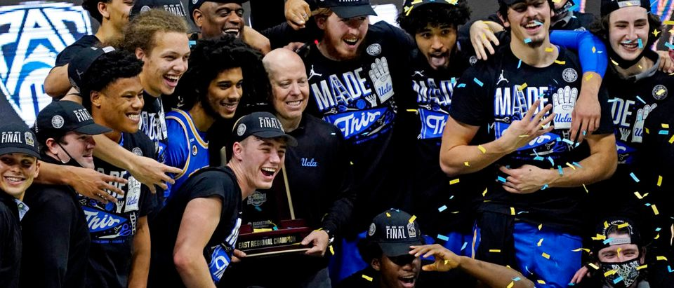 Mar 30, 2021; Indianapolis, IN, USA; The UCLA Bruins celebrate after beating the Michigan Wolverines in the Elite Eight of the 2021 NCAA Tournament at Lucas Oil Stadium. Mandatory Credit: Robert Deutsch-USA TODAY Sports via Reuters