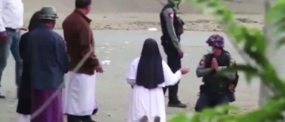 Nun begs police. Screenshot, Twitter.
