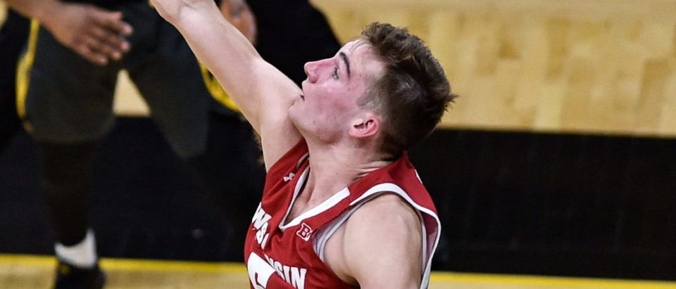 Mar 7, 2021; Iowa City, Iowa, USA; Iowa Hawkeyes guard CJ Fredrick (5) shoots the ball as Wisconsin Badgers forward Tyler Wahl (5) defends during the first half at Carver-Hawkeye Arena. Mandatory Credit: Jeffrey Becker-USA TODAY Sports via Reuters