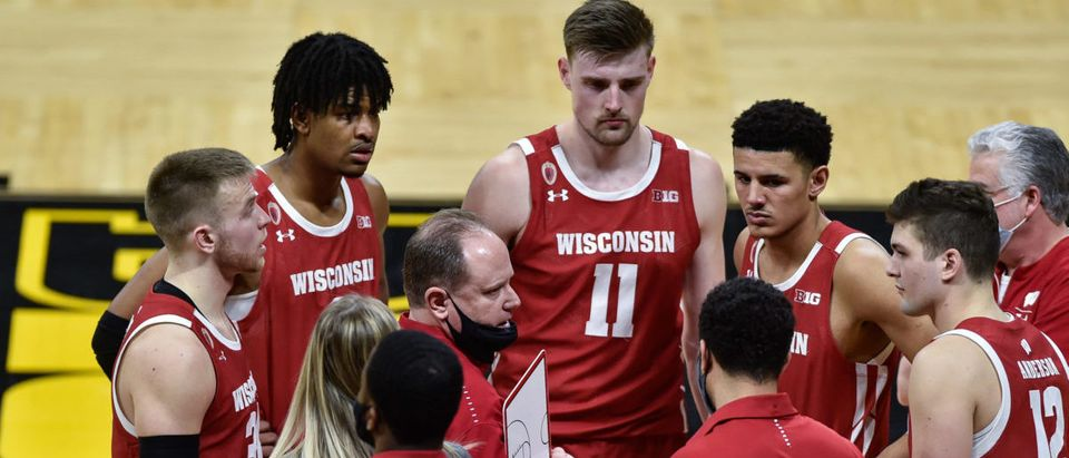 Mar 7, 2021; Iowa City, Iowa, USA; Wisconsin Badgers head coach Greg Gard talks with guard Trevor Anderson (12) and guard Brad Davison (left) and forward Micah Potter (11) late in the game during the second half against the Iowa Hawkeyes at Carver-Hawkeye Arena. Mandatory Credit: Jeffrey Becker-USA TODAY Sports via Reuters