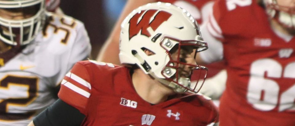 Dec 19, 2020; Madison, Wisconsin, USA; Wisconsin Badgers quarterback Graham Mertz (5) runs with the ball against the Minnesota Golden Gophers during the second half at Camp Randall Stadium. Mandatory Credit: Mary Langenfeld-USA TODAY Sports via Reuters