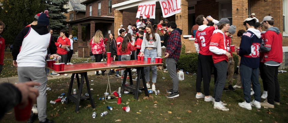 Students watch the start of Big 10 football on Ohio State campus